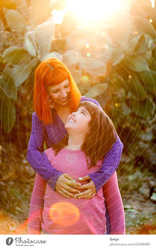 Red haired mom and her daughter Woman Child Summer Beautiful White Joy Street Lifestyle Adults Love Funny Family & Relations Laughter Happy Small Playing