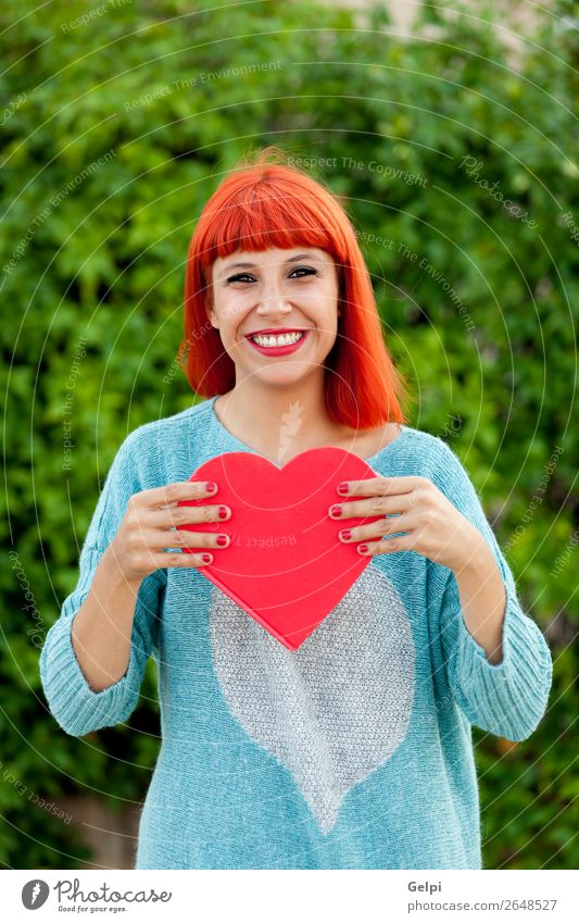 Relaxed red haired woman in the park Lifestyle Style Joy Happy Beautiful Skin Face Make-up Calm Human being Woman Adults Hand Park Fashion Red-haired Heart