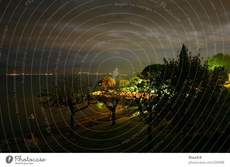Lake Garda Nightshot Italy Light Long exposure Lamp Tree Clouds Storm Town Village Europe Water Coast