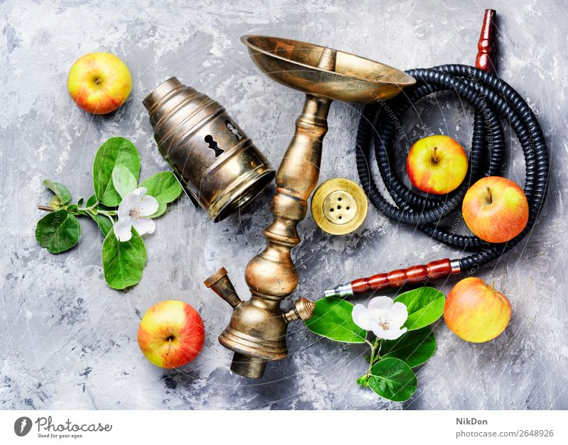 Hookah with apple hookah tobacco kalian smoke shisha east relaxation fruit blossom arabic mouthpiece pipe style turkish hookah lounge lifestyle exotic leisure