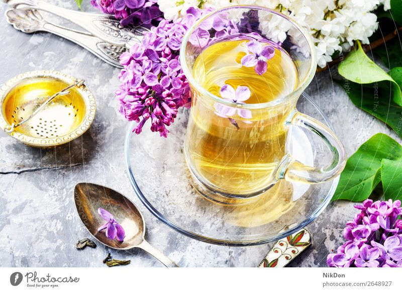 Tea with lilac flavor tea flower cup drink green table pink petal herbal nature leaf fresh spring healthy floral mug blossom glass concept natural bloom aroma