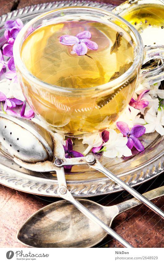 Tea with lilac flavor tea flower cup drink green pink petal herbal nature leaf fresh spring healthy floral mug blossom glass concept natural bloom aroma