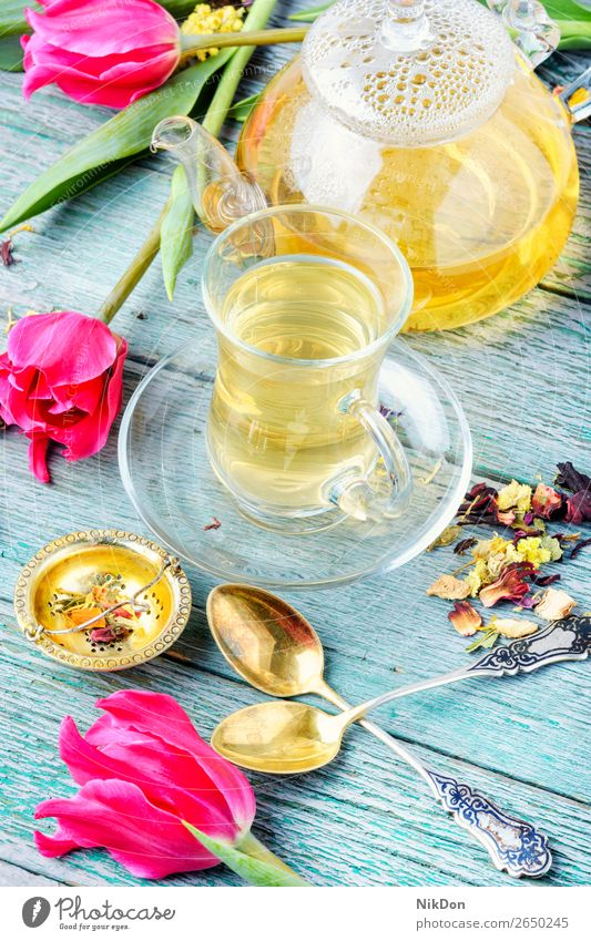 Herbal tea and spring tulip flower cup drink green table pink pot herbal nature leaf fresh healthy floral mug blossom glass teakettle natural bloom aroma