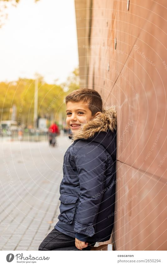 Little boy leaning on a wall. Urban scene. Child Human being Vacation & Travel Man Town Colour Beautiful Green Loneliness Joy Winter Black Street Lifestyle