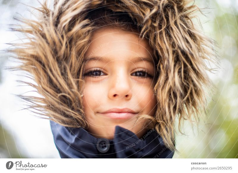 Handsome boy with a hair hood on a cold day Lifestyle Happy Beautiful Face Vacation & Travel Winter Snow Winter vacation Child Human being Baby Toddler
