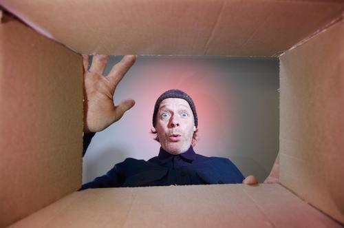 Man unpacks cardboard Human being Masculine Adults Face 1 45 - 60 years cap Anticipation Life Grasp Packing material Package Mail order selling online shipping