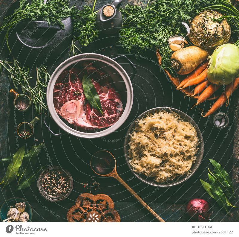 Beef leg slice in pot with vegetables on the kitchen table Food Meat Vegetable Herbs and spices Nutrition Dinner Organic produce Diet Slow food Crockery Bowl