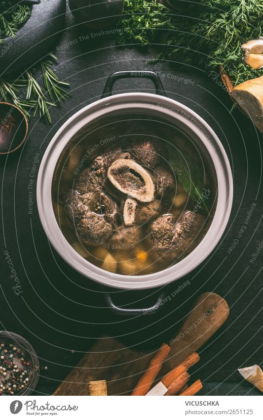 Beef broth in saucepan with boiled beef leg slice Food Meat Vegetable Herbs and spices Nutrition Lunch Dinner Organic produce Crockery Pot Style Design Kitchen