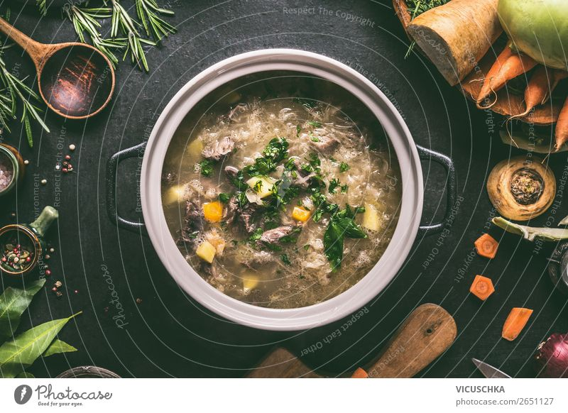 Cabbage soup in pot Food Meat Vegetable Soup Stew Herbs and spices Nutrition Lunch Dinner Diet Crockery Pot Spoon Style Design Healthy Eating Living or residing