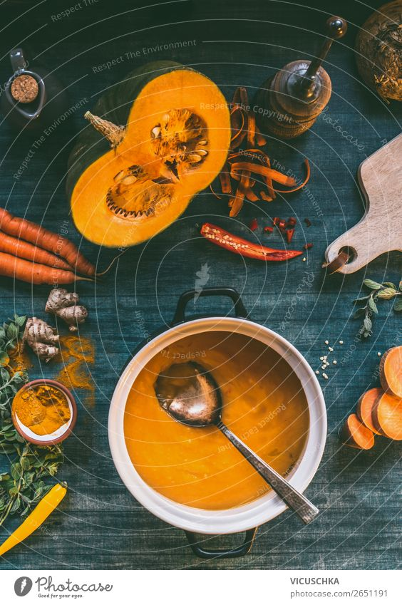 Pumpkin soup in pot on kitchen table Food Vegetable Soup Stew Herbs and spices Nutrition Lunch Dinner Organic produce Vegetarian diet Diet Crockery Pot Spoon