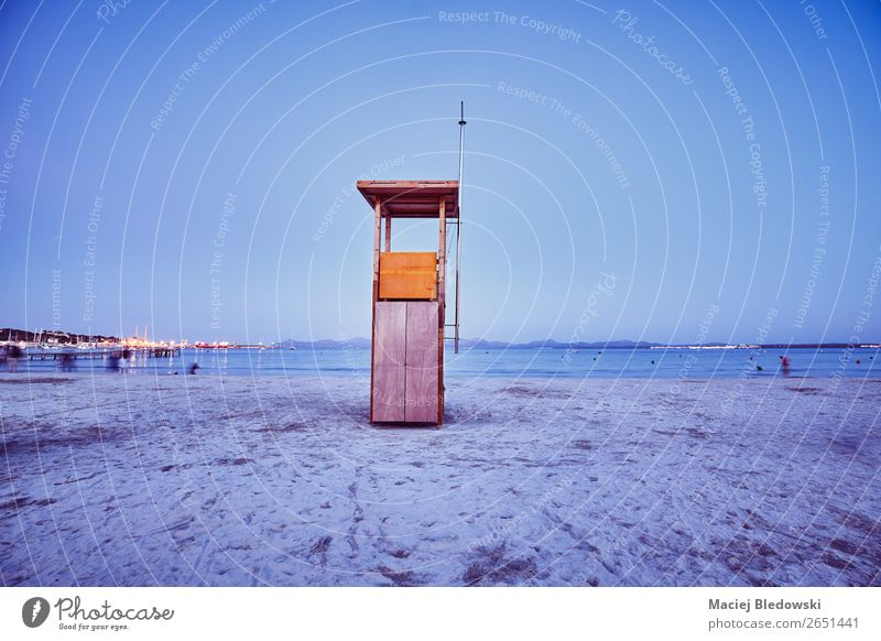 Retro toned picture of a lifeguard tower at dusk. Vacation & Travel Tourism Freedom Summer Summer vacation Beach Ocean Sand Sky Dark Blue Moody Safety Serene