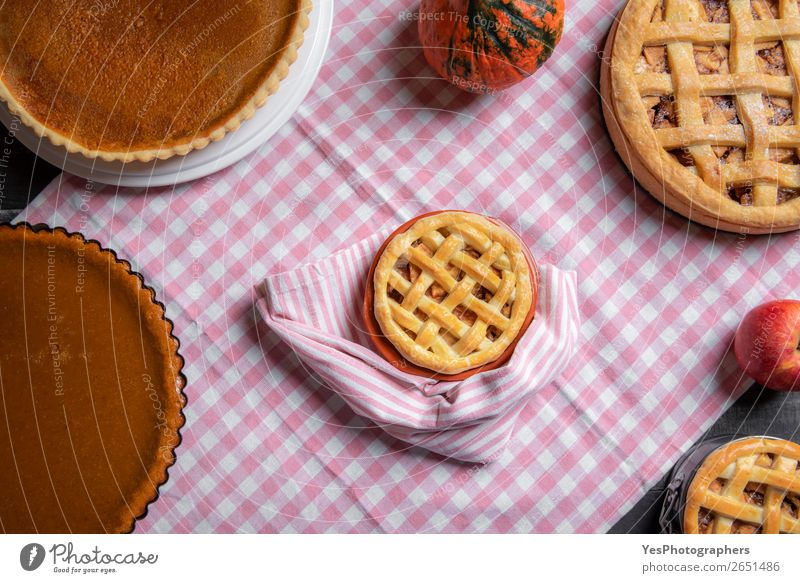 Mini apple pie surrounded by various pies. Food Cake Dessert Candy Table Kitchen Feasts & Celebrations Thanksgiving Christmas & Advent Exceptional Fresh Sweet