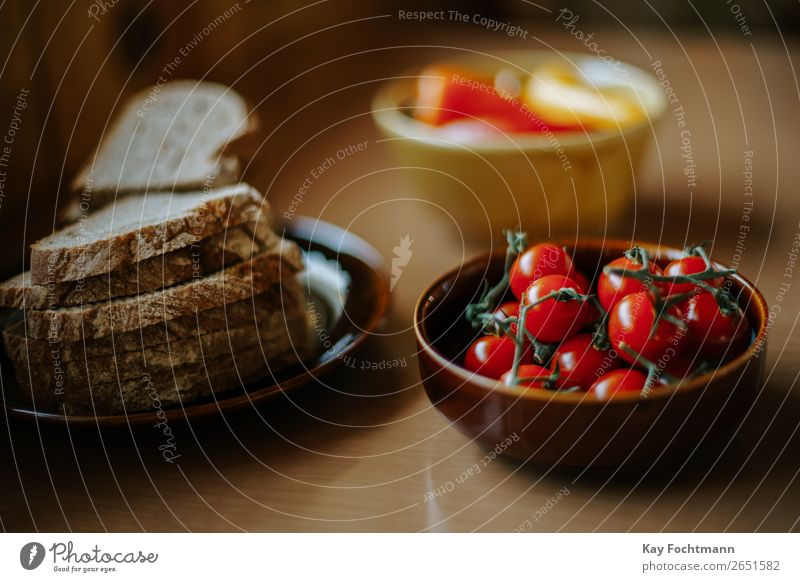 Plate with bread slices and bowl with cherry tomatoes Food Vegetable Bread Nutrition Lunch Dinner Organic produce Vegetarian diet Bowl Healthy Healthy Eating