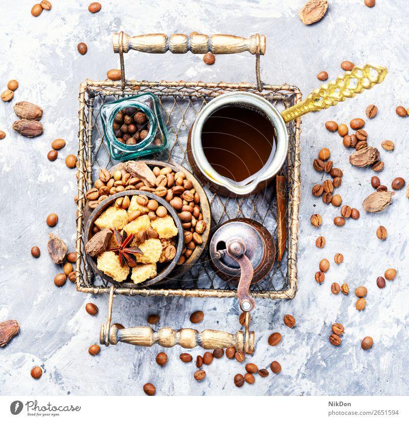 Roasted coffee beans drink grains cezve caffeine brown cafe beverage Turkish pot hot espresso black Arabic breakfast cardamom sugar spice aroma morning