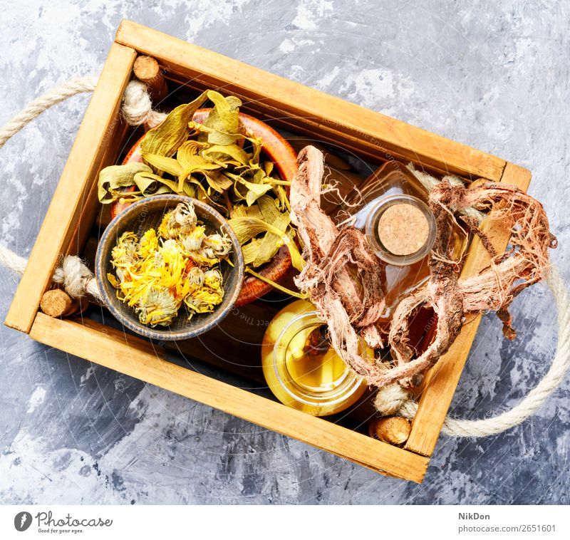 Healing herbs in wooden box herbalism herbalist natural organic medicine leaf nature health plant root flower tea medical glass drink treatment aroma remedy