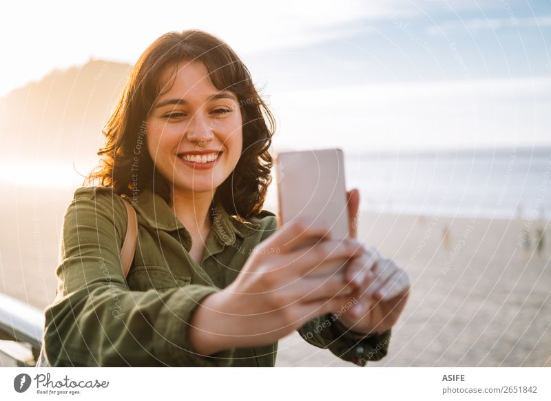 Beautiful woman taking selfie with her phone on the beach Happy Leisure and hobbies Vacation & Travel Beach Ocean Telephone Cellphone PDA Technology Woman
