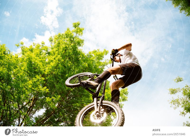 Cyclist extreme jumping Freedom Summer Mountain Sports Cycling Man Adults Nature Tree Forest Rock Jump Strong Rider bike Extreme bicycle young Motorcycling