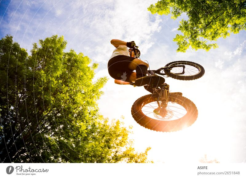 Young cyclist extreme jump Nature Man Summer Tree Forest Mountain Adults Sports Freedom Rock Jump Action Cycling Strong Balance