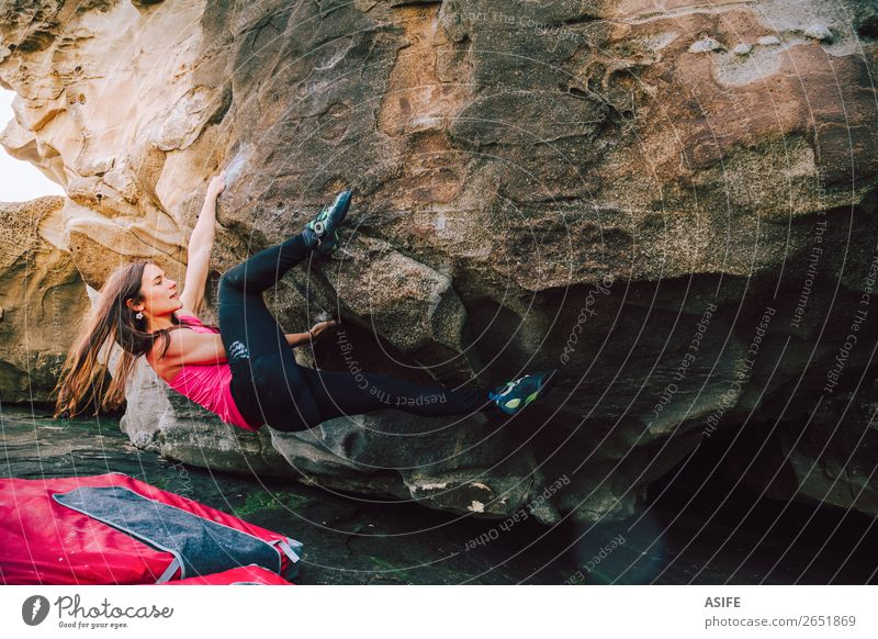 Brave young rock climber woman Joy Happy Beautiful Leisure and hobbies Adventure Ocean Mountain Hiking Sports Climbing Mountaineering Woman Adults Nature Rock