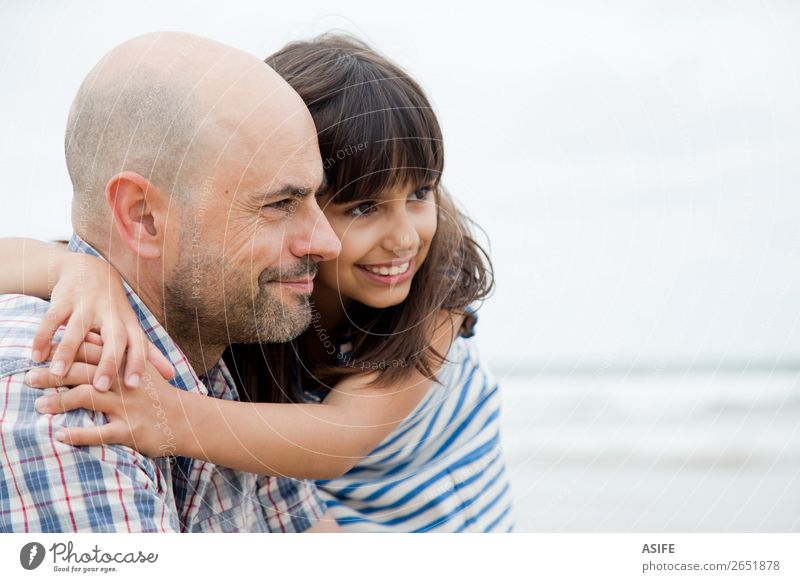 Father and daughter looking ahead Joy Happy Beautiful Beach Ocean Child Parents Adults Family & Relations Clouds Bald or shaved head Smiling Laughter Love