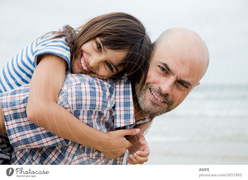 Beautiful father and daughter portrait Joy Happy Beach Ocean Child Parents Adults Father Family & Relations Clouds Bald or shaved head Smiling Laughter Love