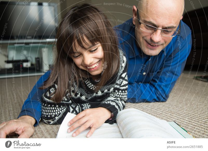 Fun with dad Lifestyle Joy Happy Leisure and hobbies Reading Living room Parenting Child School Parents Adults Father Family & Relations Friendship Infancy Hand