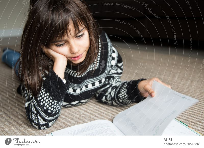 Little girl reading a book Lifestyle Joy Happy Beautiful Relaxation Leisure and hobbies Reading Child School Human being Woman Adults Family & Relations Infancy