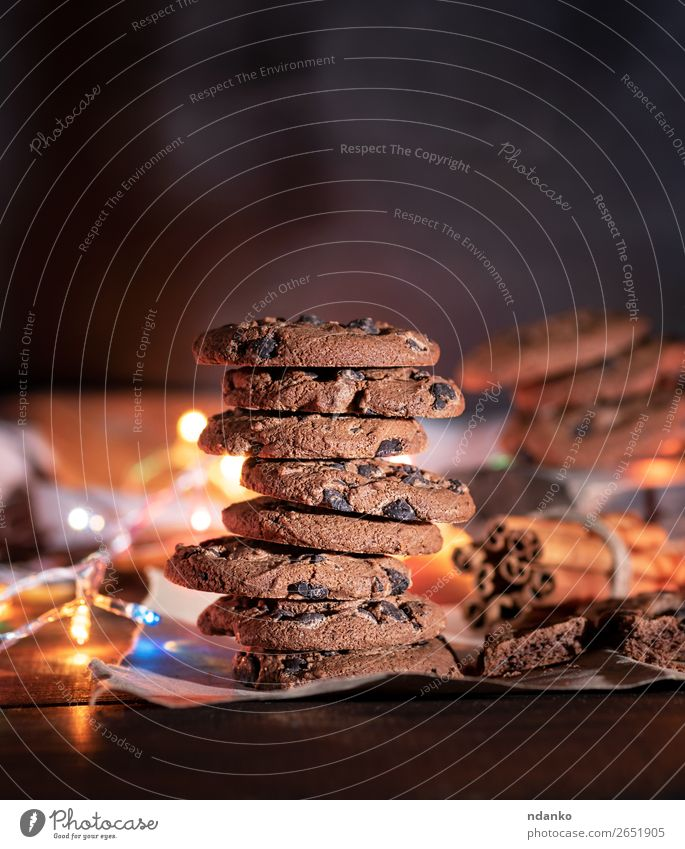 round chocolate cookies in a stack Food Cake Dessert Candy Chocolate Breakfast Feasts & Celebrations Christmas & Advent Wood Eating Dark Delicious Brown Moody