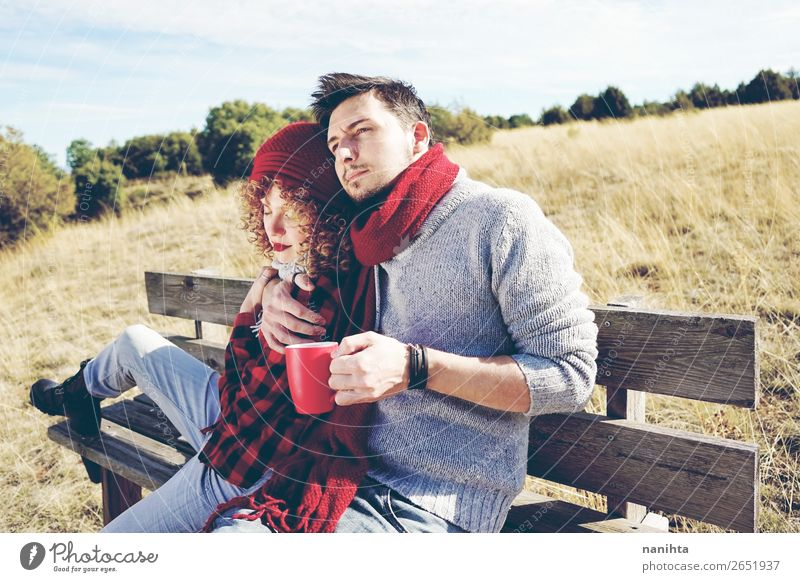A couple of happy young people in love Coffee Tea Lifestyle Happy Relaxation Calm Sunbathing Human being Masculine Feminine Woman Adults Man Family & Relations