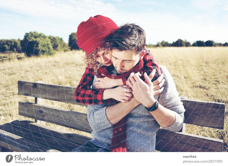 A couple of happy young people in love Woman Human being Man Relaxation Calm Lifestyle Adults Wood Autumn Love Happy Couple Together To enjoy Bench