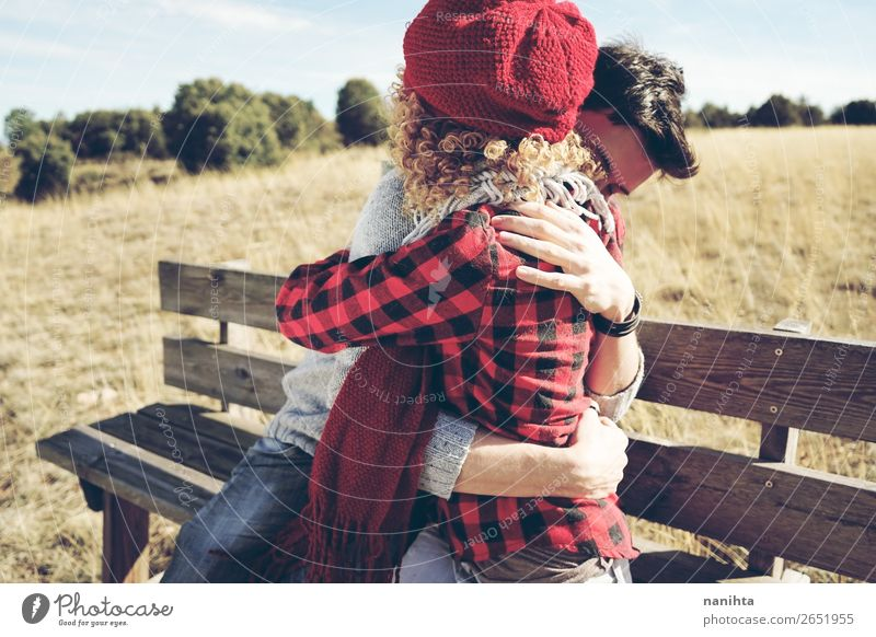 A couple of happy young people hug each other Woman Man Relaxation Calm Lifestyle Adults Wood Autumn Love Family & Relations Happy Couple Together Sit To enjoy