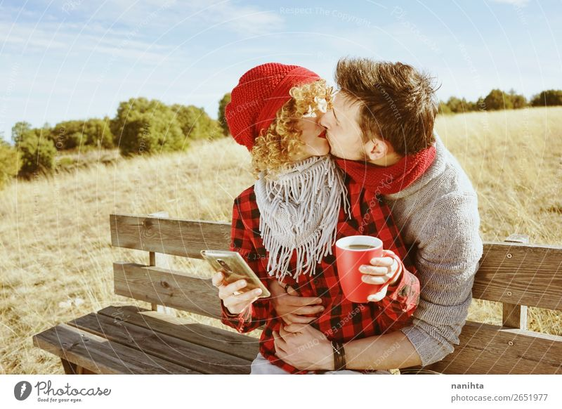 A young couple in love kiss Woman Human being Youth (Young adults) Man Relaxation Calm 18 - 30 years Lifestyle Adults Wood Autumn Love Feminine Happy Couple