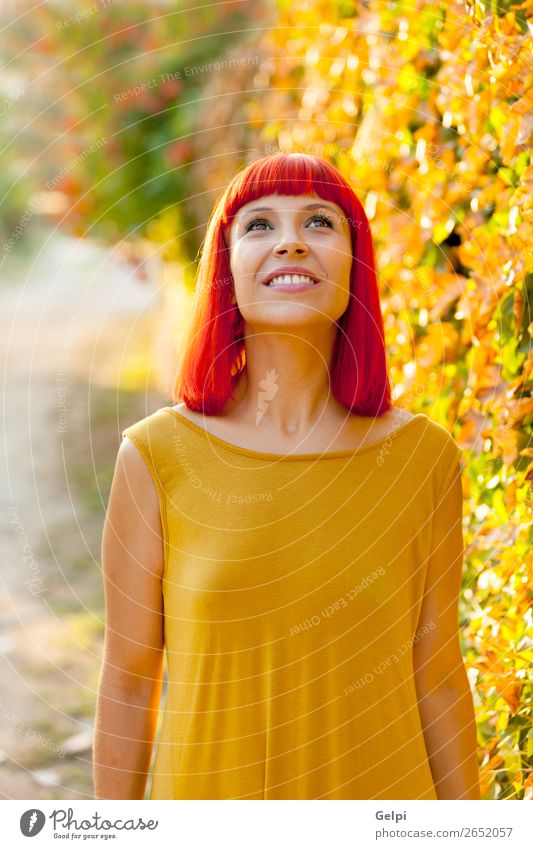 Pensive red haired woman in a park looking up Woman Human being Nature Summer Plant Colour Beautiful White Red Eroticism Calm Face Lifestyle Adults Yellow Happy