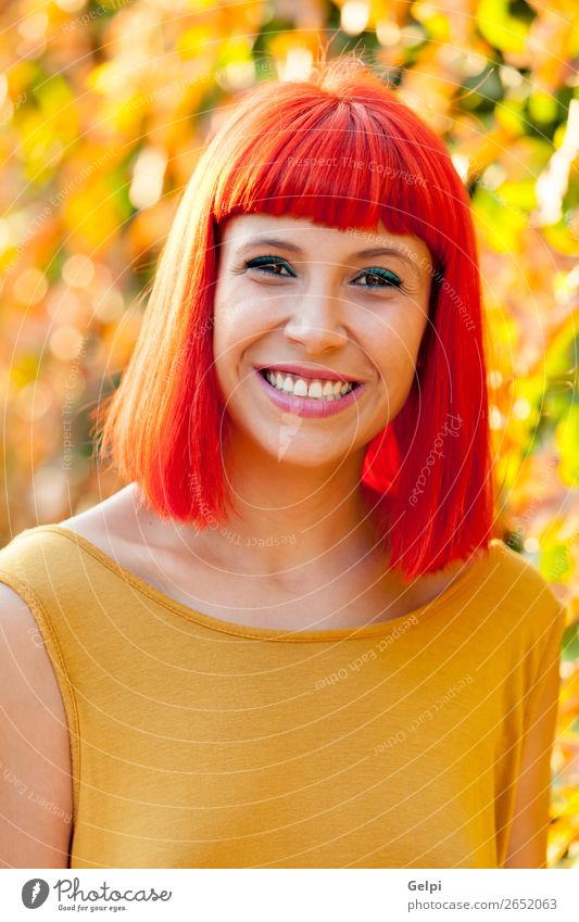 Beautiful red haired woman in a park Lifestyle Style Joy Happy Hair and hairstyles Face Wellness Calm Summer Human being Woman Adults Nature Plant Park Fashion