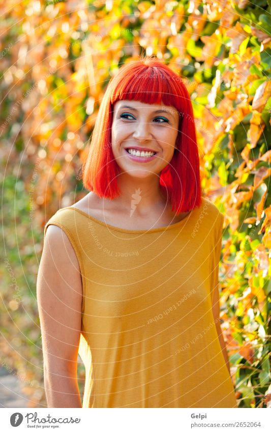 Beautiful red haired woman in a park Woman Human being Nature Summer Plant Colour White Red Eroticism Calm Joy Face Lifestyle Adults Yellow
