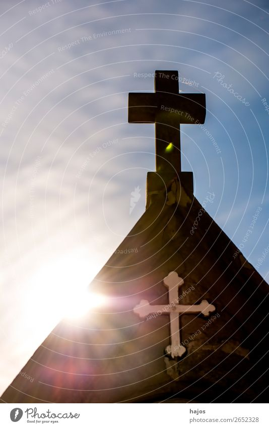 Cross of a Way of the Cross station on a pilgrim path in backlighting Crucifix Religion and faith christian Back-light Sun rays Catholic cross symbol Atonement