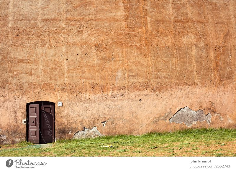 Wall (building) Meadow Wall (barrier) Orange Brown Living or residing Fear Door Power Dangerous Large Transience Italy Threat Protection Safety
