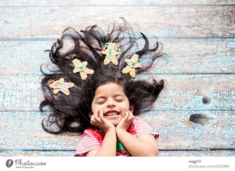 Cute cheerful smiling girl with decorated Christmas hair Style Joy Happy Beautiful Hair and hairstyles Face Winter Decoration Feasts & Celebrations