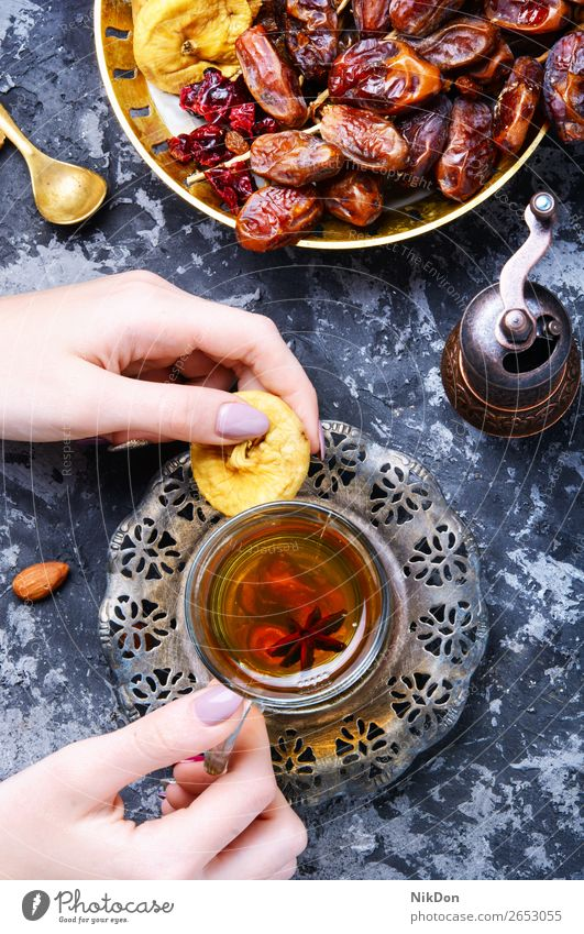 Cup of Turkish tea oriental hand drink fig fruits cup healthy teapot east hot beverage chinese asian herb table eastern arabic turkish relaxation arabian exotic