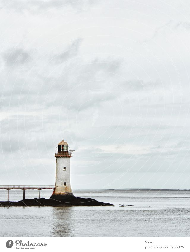 lighthouse Landscape Sky Clouds Rock Coast Ocean Horizon Ireland Bridge Tower Lighthouse Manmade structures Blue White Calm Loneliness Signal Window Water