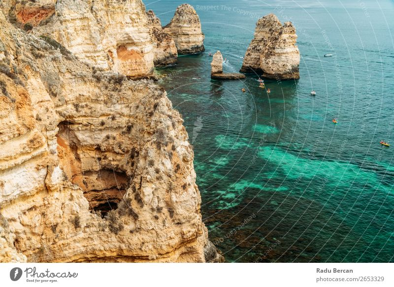 Rocks, Cliffs And Ocean Landscape At Lagos Bay Coast In Algarve, Portugal Nature Hole Cave Beach Stone Arch Window Vantage point Beautiful Vacation & Travel