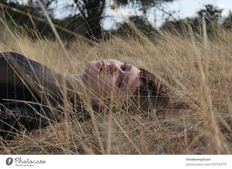 Young woman lying on a dried summer meadow Feminine Youth (Young adults) Head Face 1 Observe Relaxation Dream Sadness naturally Rebellious pretty Emotions Calm