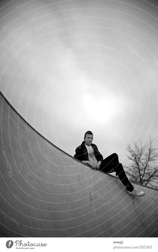 hanging around Masculine Young man Youth (Young adults) 1 Human being Sky Clouds Cool (slang) Dark Round Arch Sit Lie Hang Concrete Concrete wall