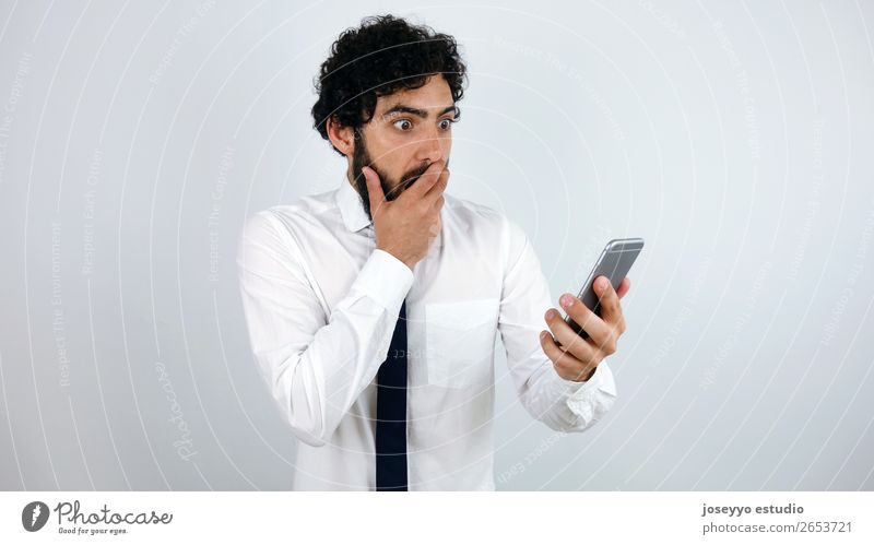 Business man with mobile phone in his hand Amazed Beard Businessman To call someone (telephone) Cellphone Communication Expression Face Forget Hand Internet