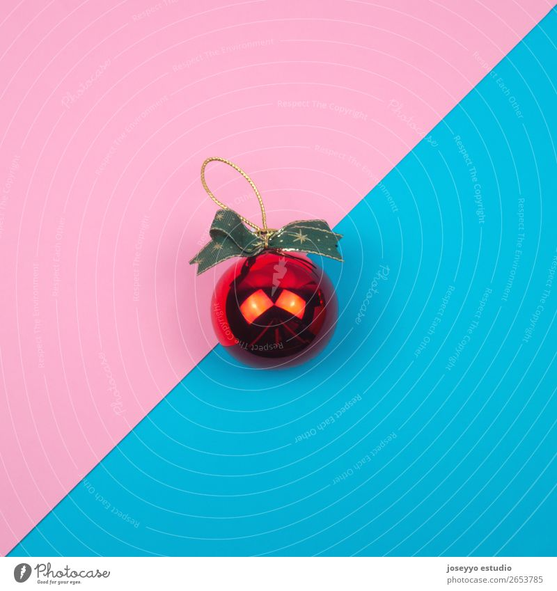 Red christmas ball on blue and pink background. Design Winter Decoration Feasts & Celebrations Ball Craft (trade) Simple Above Blue Pink Creativity Banner Blank