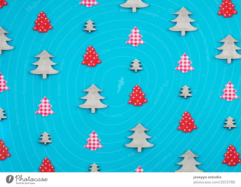 Christmas pattern made of christmas trees. Design Winter Decoration Feasts & Celebrations Craft (trade) Paper Simple Above Blue Red White Creativity background