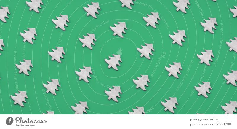 Christmas pattern made of wooden christmas trees. Design Winter Decoration Feasts & Celebrations Craft (trade) Paper Simple Above Green White Creativity