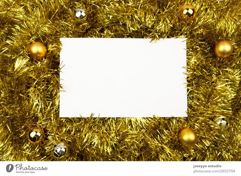 White card with copy space on golden tinsel. Design Happy Winter Decoration Feasts & Celebrations New Year's Eve String Simple Above Gold Creativity background