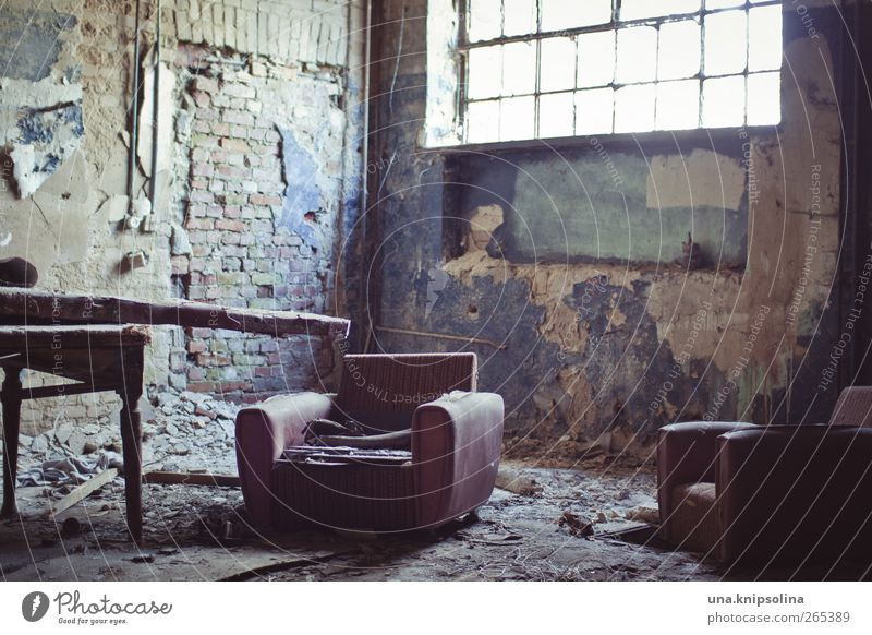 seating furniture Furniture Armchair Table Room Ruin Wall (barrier) Wall (building) Window Old Dirty Broken Chaos Decline Past Destruction Derelict Colour photo