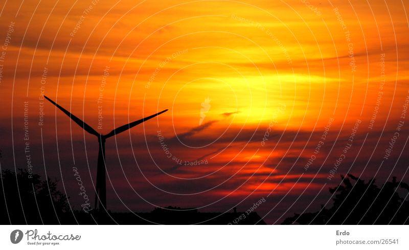 Wind turbine at sunset Roof Sunset Yellow Black Wind energy plant Orange